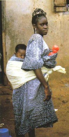 Noimoto, a Yoruba woman, is using a plastic doll as an ere Ibeji Photographed by Marilyn Houlberg, Igbo-Ora, Nigeria,  1970