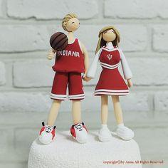Indiana University basketball player and cheerleader couple wedding cake topper