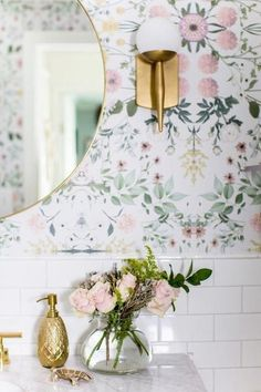 Check out this beautiful DIY bathroom with pink floral wallpaper, brass accents, a round mirror, marble vanity, subway tiles. Its a girly decor dream! For a small bathroom it sure is big on style! Bold Wallpaper, Trendy Wallpaper, Flower Wallpaper, Wallpaper Ideas, Small Bathroom With Wallpaper, Wallpaper Accent Wall Bathroom, Bathroom Counter Decor, Diy Bathroom, Home Decor