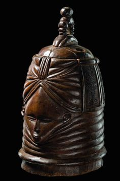 """Africa   Helmet mask """"Sowei"""" from the 'bundu' society among the Mende people of Sierra Leone   Wood; shiny brown patina"""
