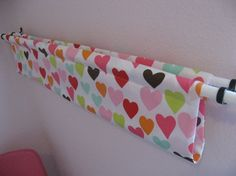 Diy book sling. [I'd add that it would be an adorable corral for stuffed animals and dolls! Displayed in a cute way but up off the floor.]  Fabric shower curtains would be perfect -- could even attach with cute rings.