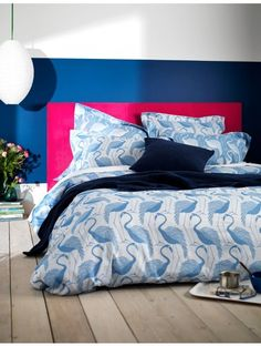 Bright blue flamingo bedding set. Amazing quality and sure to make a statement. A bright bedroom at its best!