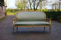 I like the masculine stripes on this french sofa settee