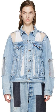 Long sleeve denim jacket in 'bleach' blue. Fading, distressing, and staining throughout. Semi-sheer organza panelling in white throughout. Spread collar. Button closure at front. Flap pockets and logo flag in red at bust. Mock welt pockets at waist. Single-button barrel cuffs. Buttoned cinch straps at back hem. Antiqued copper-tone hardware. Contrast stitching in tan.  Part of the Off-White x Levi's collaboration.
