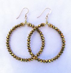 A personal favorite from my Etsy shop https://www.etsy.com/listing/453329258/gold-metallic-crystal-hoop-earrings
