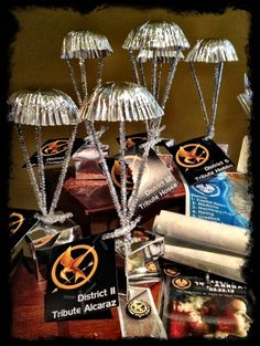 Hunger Games party decoration idea Parachutes with baskets of goodies hanging from the ceiling. SUCH a great idea! Must do. According to the weu2026 & Hunger Games party decoration idea: Parachutes with baskets of ...