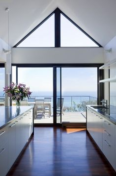 Like the white cabinets with the wood floor