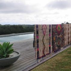 """@mossandtwine on Instagram: """"These rugs look amazing even laying over the fence waiting to be styled location @thegrovebyronbay ⭐️product @marr_kett #styling #luxe #rugs #location #byronbay #landscape #wool #collection #colourblast #boho"""""""
