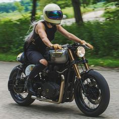 """caferacersofinstagram: """" @jessicahaggett out for a ride on @analogmotorcycles Triumph Bonneville build for @rebelyellbourbon. . Photo by @whiplashracing. . . #croig #caferacersofinstagram #caferacer """""""
