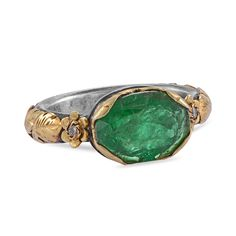 This exquisite one of a kind ring has been handmade in our workshops. It has a central large emerald, set in gold hand engraving work and is flanked by two full cut diamonds. The base of the ring is oxidised silver. It would make a lovely engagement ring. Alternative Wedding Jewellery, Alternative Engagement Rings, Diamond Crown Ring, Emerald Ring Gold, Wedding Gifts For Groom, Pink Tourmaline Ring, Dress Rings, Gold Hands, Rings Online