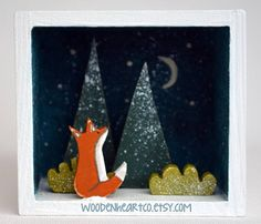 Little Fox, English Christmas, Winter Snow Scene, gift, trees, animal, miniature, little, diorama, box, miniature, frame cute, forest, tiny  This sweet, little winters night scene features a tiny fox sitting in the snow amongst the trees, under the moonlight.  Each element is hand-cut from ply wood, hand-painted, lightly sanded and then sealed with a matt varnish.  The vignette is nestled inside a white washed wooden box, it is free-standing but is also light enough to exhibit on a wall…