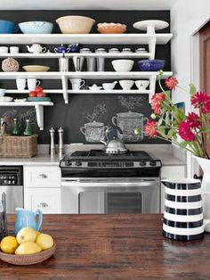 LOVE the open shelving and chalkboard wall  Doing this! with pops of red and green