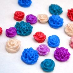 Create your own flower cabochons using polymer clay, then turn them into whatever you like! Rings, pins, necklaces, earrings...the sky's the limit! Posted by oneartsymama