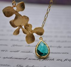 Blue Orchid Necklace ocean blue orchid flower gold, bridal jewelry, bridesmaid gifts, elegant jelwery. $21.99, via Etsy.