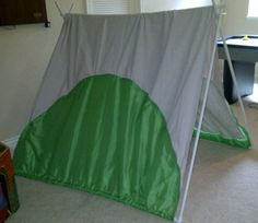 """PVC Tent.  4-10' 1/2"""" pipes, cut in half.  4 1/2"""" 90 degree connectors. Used a painters drop cloth and decorated. $18.00 total and since the cloth pkg came with two, can spend $8. More and make second one. Used zip ties at peaks."""