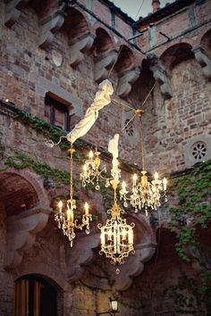 a grouping of small chandeliers for an outdoor party... if only this could be done... LOVE