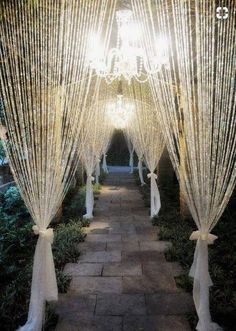 Add a sophisticated glimmer to your decor with this crystal curtain. It features 34 garlands of iridescent acrylic crystal beads. Each bead is smaller than 1/2. The top of the curtain has a 36 long pole with 2 hooks for hanging. No assembly required. This curtain is 6 Yards/216