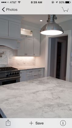 White princess quartzite with backsplash Condo Kitchen, Kitchen Counters, Granite Kitchen, Kitchen Redo, Kitchen And Bath, New Kitchen, Kitchen Remodel, Kitchen Ideas, Kitchen Design