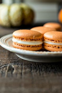 Pumpkin Cheesecake Macarons - A classic chewy french cookie is given a fall makeover with a pinch of pumpkin spice, cream cheese buttercream, and pumpkin butter. Pumpkin Oatmeal Cookies, Pumpkin Butter, Pumpkin Spice, Macaron Flavors, Macaron Recipe, Macaron Cookies, Delicious Desserts, Dessert Recipes, Yummy Food