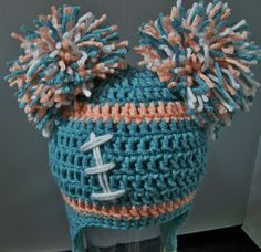 Crocheted baby girl football beanie  Miami Dolphins or Any Team Any Color Combination Cute photo prop. $20.00, via Etsy.