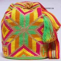Cabo Wayuu Mochila bags are intricate in their designs, can take approximately 15 days to weave. Handmade in South America by the indige Crochet Handbags, Crochet Purses, Beautiful Handbags, Tapestry Crochet, Crochet Basics, Bead Crochet, Crochet Fashion, Purses And Bags, Hand Weaving