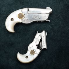 Hopkins  Allen Derringer - The factory called it the New Model Vest Pocket Derringer during its production run from 1911 to 1915 and only about 1,400 of these diminutive .22 handguns were made. This engraved example bears factory mother-of-pearl grip panels. At the NRA National Firearms Museum in Fairfax, VA