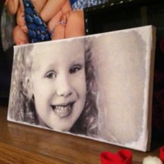 DIY Canvas photo. Print the photo on tissue paper (tape tissues paper to regular printer paper and send through like normal paper), modpodge to canvas, then paint edges to hide end of tissue lines.