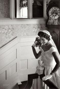 "Sept. 12, 1953. Newport, Rhode Island. ""Kennedy wedding -- Jacqueline Kennedy throwing the bouquet."" Gelatin Silver print by Toni Frissell"