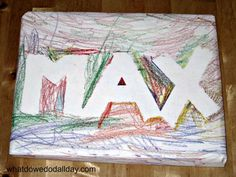 This is a great gift wrap technique that kids can do!  Tape resist -- and it personalizes the package.