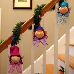 Elves! Hand painted light bulbs mixed in with garland for your stairs.