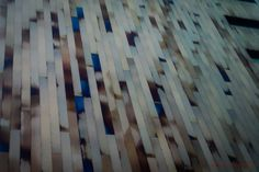 78/366 - Planked - Extremely unusual cladding on the outside of the Crowne Plaza hotel in Lille shot from a taxi window with the iPhone.  But I'm going home!