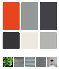 Shale Grey Cool, dark exterior colors contrast with the warm orange accents. Walker chose blue and gray stone, paint and polished concrete to tone down the occasional bright hues. Exterior Gris, Exterior Door Colors, Modern Exterior Doors, Exterior Color Schemes, Stone Exterior, Terrace House Exterior, House Paint Exterior, Office Color Schemes, Colour Schemes