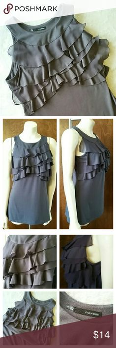 Maurices Grey Ruffled Blouse Women's Medium Maurices Women's Medium Sleeveless Ruffled Grey Gray Knit Top with Stretch  In very nice, clean condition  80% Polyester 16% Rayon 4% Spandex Machine wash cold Tumble dry low  27 1/2 inches long 17 1/2 inches across chest 9 inch long arm opening 16 inches across waist  Please email me with any questions Smoke Free Fast Shipping Thank You and Happy Poshing! Maurices Tops