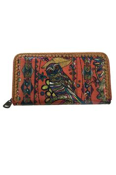 Beautiful owl print. Very durable! Antique brass tone hardware.Zipper closure. Interior features 12 credit card slots and a zippered coin pocket. Back pocket each side for bills. Wipe clean with barely damp cloth and air dry.    Dimensions:8in L x 1in W x 4.5in H   Large Zip Wallet by Sakroots. Bags - Wallets & Wristlets Canada