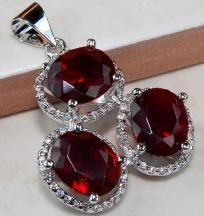 WELCOME TO CINDERELLA'S REVENGE  ~Home of Very Cool Stuff at even Cooler Prices Sold to the Coolest People~  RICH ROYAL RED & WHITE TOPAZPENDANT IN A SETTING OF HALLMARKED SOLID 925 STERLING SILVER.THESE STONESARE EYE CLEAN,OVAL RED TOPAZ SURROU...