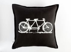 White bicycle print on black linen pillow  by pillowlink on Etsy, $35.00