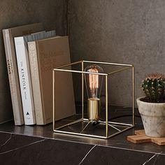 The Beacon Lighting Itlas 1 Light metal table lamp in brass.