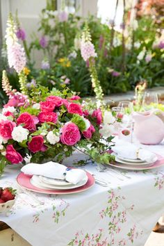 This Pink Mother's Day Table is filled with blooms galore! From Paula Deen. #mothersday #tablescape