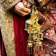 Golden kaliras with gold chain and red stone droplets. Image � Pinterest via Sherlyne - bollywoodshaadis.com
