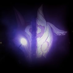 Kindred, League of Legends. Read the story. http://na.leagueoflegends.com/en/page/good-death