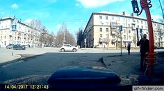 Guy Tries to Fix Traffic Light With Stick, Fails Remarkably