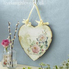 Love this little distressed floral print shabby chic heart shaped wall plaque, hung with ribbon - would be perfect frame for a word - not sure which word yet. :)  - #ShabbyChic #Crafts #Hearts - pb†å