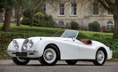 1953 Ivory Jaguar XK120 Roadster    source: RM Auctions
