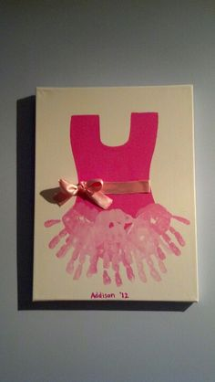 It worked out great. I painted the dress part instead of cutting out pink construction paper. The piece looks more cohesive with all paint. And once the paint dried, we did the hand prints. I used two different pinks for the tutu part, both were a lighter color than the dress. And once the hand prints were dry, I just glued some pink ribbon the artwork and tied a bow :)