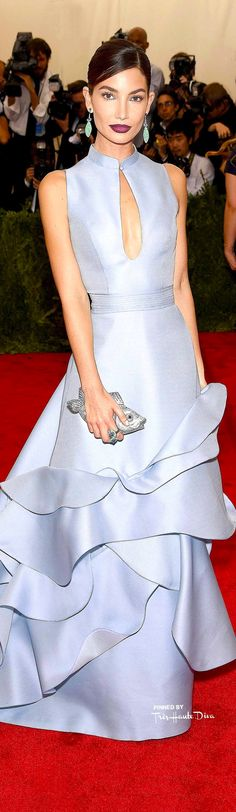 Lily Aldridge in Carolina Herrera  ~  Spring Silver Blue Sleeveless Gown with Layered Ruffle Skirt,  2015