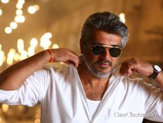Download the latest unseen image stills of Thala Ajith Kumar. Exclusive HD photos of actor ultimate star ajith gallery.
