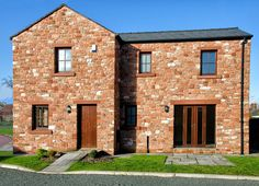 This home is fabulous with its stunning brickwork and classically finished windows and doors!