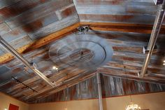 rustic tin ceiling and old windmill ceiling fan..love it.
