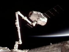 FIRST UNMANNED COMMERCIAL SPACE FLIGHT DOCKS WITH THE ISS