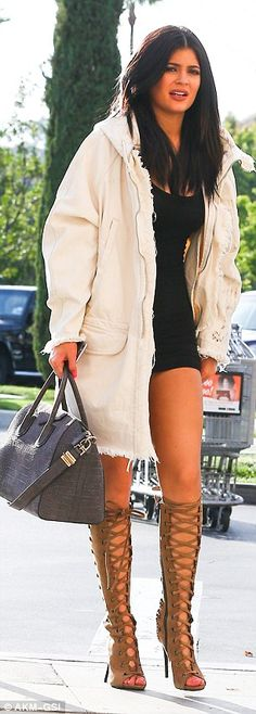 Quick change: Kylie Jenner wore not one, but two leggy looks for a lunch outing with BFF Pia Mia, 18, and rumoured boyfriend Tyga, 25, in her native Calabasas, California on Sunday